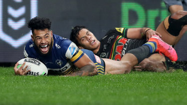 Former Panther Waqa Blake kick-starts the Eels' stunning comeback with a try in the 62nd minute.