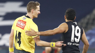 Arguing the toss: Eddie Betts speaks with the umpire during Carlton's win over Essendon.