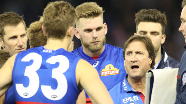 Barking out commands: Luke Beveridge gets the message to his players.