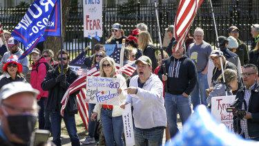 Hundreds of protesters gather outside Minnesota Gov. Tim Walz' official residence,