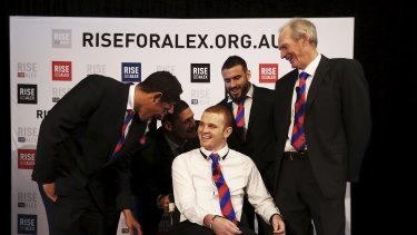 Then Knights players Dane Gagai, Korbin Sims, Willie Mason and Darius Boyd share a joke with Bennett and McKinnon.