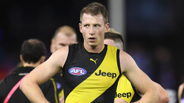 Nervous wait: the loss of defender Dylan Grimes would be a blow as Richmond aim for a top-two finish.