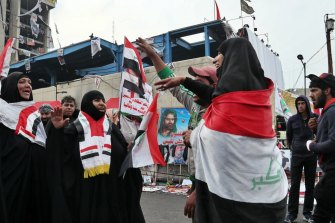 Demonstrators gather at Tahrir Square during ongoing anti-government protests in Baghdad on December 2.