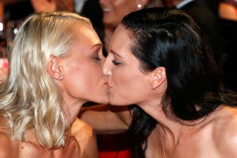 Erin Phillips (left) kisses wife Tracy Gahan