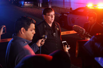 Fresno Police Lt Bill Dooley speaks to reporters at the scene of a shooting at a backyard party.