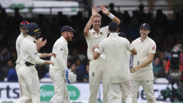 Grinners: Stuart Broad has helped bowl England to victory over India in the second Test at Lord's.