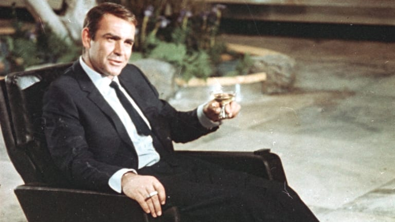 The glass has changed, but Bond's choice of choice has remained the same. Sean Connery sips martini as James Bond.