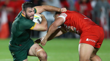 Mate against mate: James Tedesco is tackled by club teammate Sio Siua Taukeiaho in Auckland.