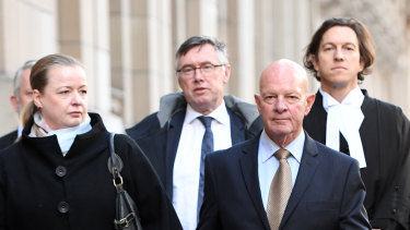 Clifford John Gerathy (second from right) leaves the Supreme Court in Melbourne earlier this year.