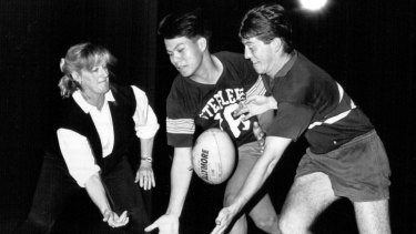 Australian pioneer: Marguerite Howard (nee Towers) passing on her knowledge to young Queensland players in 1990.
