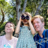 What's that bird? Audra Coxhill, 7, centre with Melbirds authors Cindy Hauser and Michael Livingston, at Trin Warren Tam-boore wetland in Royal Park.