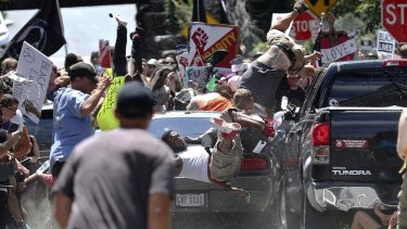 People fly into the air as a vehicle is driven into a group of protesters demonstrating against a white nationalist rally in Charlottesville, Virginia in 2017.