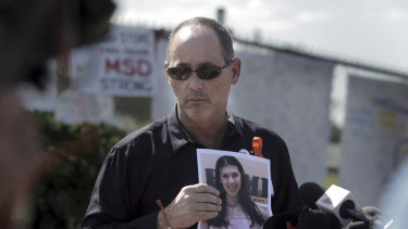 Fred Guttenberg holds a picture of his daughter Jamie, killed in a high school shooting.