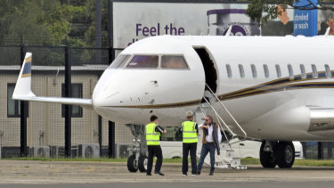 Andrew Forrest at Sydney airport on January 3 boarding the FMG private jet to fly back to Perth.