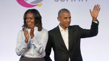 Former president Barack Obama, right, and former first lady Michelle Obama appear at the Obama Foundation Summit in Chicago in 2017.