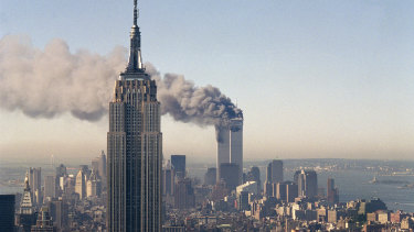 The twin towers of the World Trade Centre burn behind the Empire State Building in New York on September 11, 2001.