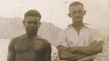 Tom Phelps (r) with his friend Una Beel in New Guinea before their village was bombed by the Japanese.