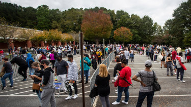Hundreds of people wait in line for early voting in Marietta, Georgia.
