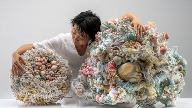 Artist Hiromi Tango pictured with her sculptures: 'Kimono's Will (Mother)', right and left,' Kimono's Will (Daughter)', both 2019.