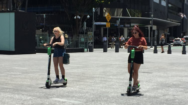 Lime scooter riders risk brain injury and death while zipping around without helmets on in Brisbane city.