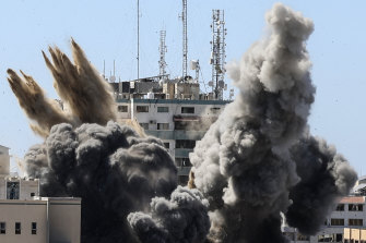 Smoke billows from a building housing various international media after an Israeli airstrike.