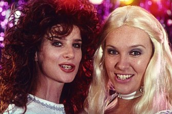 Griffiths, left, with Toni Collette in PJ Hogan's 1994 film Muriel's Wedding.