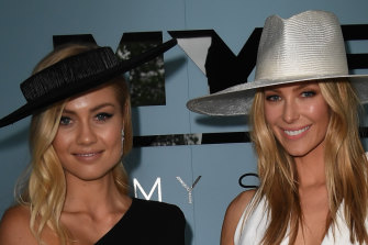 Elyse Knowles (left) and Jennifer Hawkins are seen at the Myer Fashions on the Field enclosure during the AAMI Victoria Derby Day, as part of the Melbourne Cup Carnival, at Flemington Racecourse in Melbourne, Saturday, November 3, 2018.