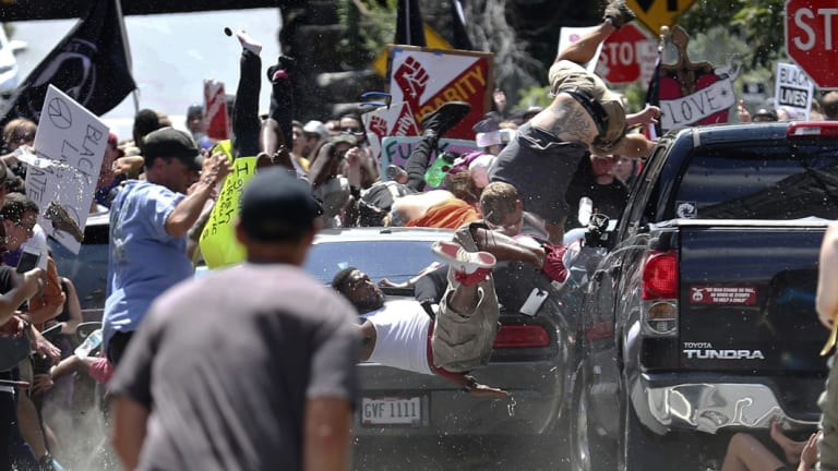 People fly into the air as Fields' vehicle is driven into a group of protesters demonstrating against a white nationalist rally in Charlottesville, Virginia.