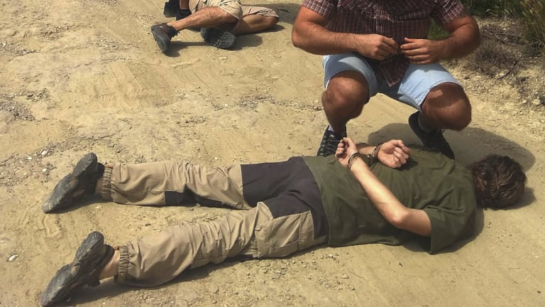 Suspect Jos Brech is detained by Spanish police officers in the countryside of the province of Barcelona, north-eastern Spain.