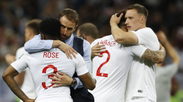 England head coach Gareth Southgate comforts players after England's loss.