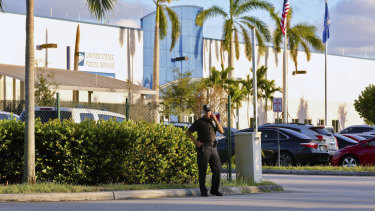 Police presence outside the US Post Office Royal Palm Processing and Distribution Centre in  in Opa-Locka, Florida.
