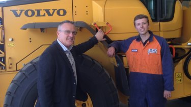 CJD Equipment general manager Michael Lombardo with first year apprentice Lachlan Biffin