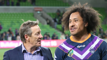 Craig Bellamy with Felise Kaufusi after Storm's one-point qualifying final win over South Sydney on Friday night.