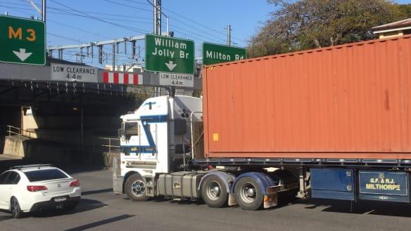 Truck stuck at Brisbane CBD rail bridge during peak hour