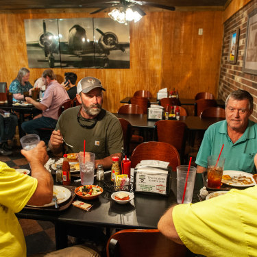 """Left to right: Mitch Reginelli, Bruce Craig, Nicholas Kovach and James Lemonis gather for lunch at Catfish Cabin in Boyle, Mississippi: """"haven't run into the vaccinator yet""""."""