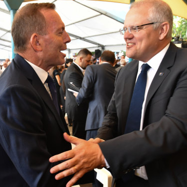 Former prime minister Tony Abbott and Prime Minister Scott Morrison at Good Friday Easter services at St Charbel's Catholic Maronite Church at Punchbowl.