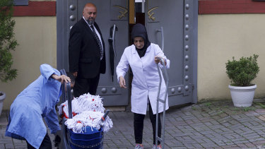 Cleaning personnel enter Saudi Arabia's Consulate in Istanbul before police arrived.