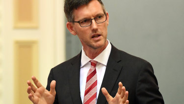 """""""People should not be travelling on coaches or trains across Queensland unless they have an essential reason to,"""" Transport Minister Mark Bailey said."""