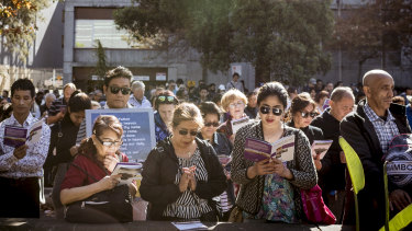 Melburnians gathered in prayer in the sun at one of the stations of the cross.