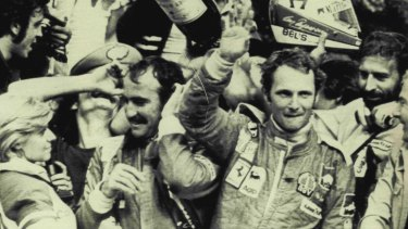 Niki Lauda waves to the crowd after being crowd world champion in 1975.