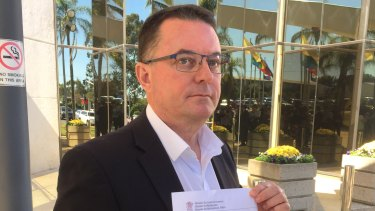 Logan mayor Luke Smith with the letter from Local Government Minister Stirling Hinchliffe, which formally suspended him on Tuesday, May 22, 2018.