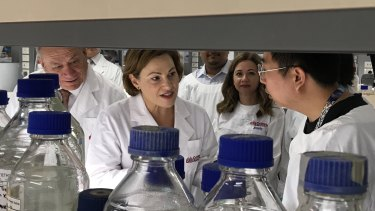 Deputy Premier Jackie Trad inspects the Griffith University lab where the spinal repair research is taking place.