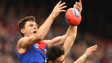 Jake Lever flies for the grab during the Demons' 109-point win over the Blues on Sunday.