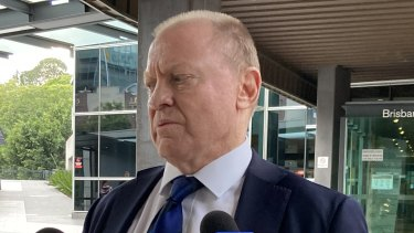 Former crime journalist and now chairman of the Gold Coast Titans NRL club Dennis Watt leaves court  on Tuesday.