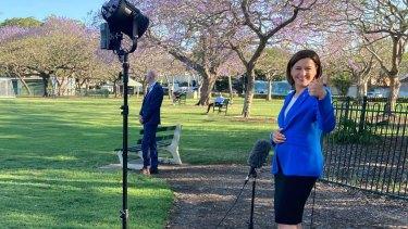 LNP leader Deb Frecklington does a live TV cross in Brisbane's New Farm Park.