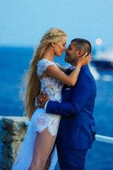 John Macris and his wife Victoria Karyda on their wedding day in Mykonos.