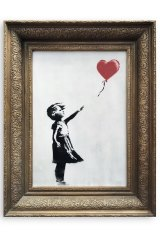 Banksy's 'Girl with Balloon' before it was shredded.