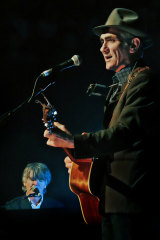 Paul Kelly performs with Neil Finn in 2013.