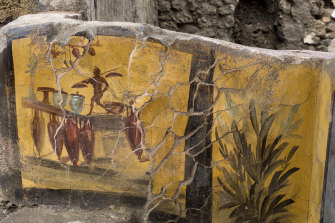 The front of the shop was covered in frescoes, including one showing a snack shop's offerings.