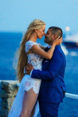 John Macris and his wife Victoria Karyda on their wedding day in Mykonos.